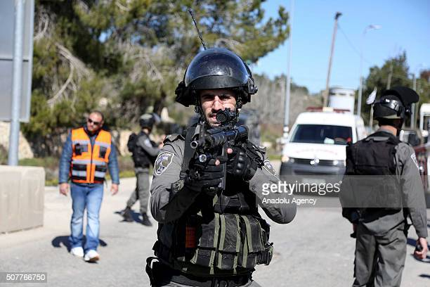 Israeli soldiers take security measures at the Beit El check point after they shot dead a Palestinian who allegedly opened fire at them in Ramallah...