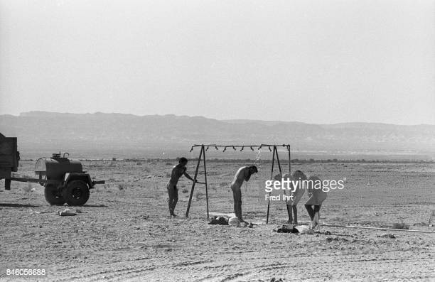 Israeli Soldiers taking a shower in the field on the Golan Heights during the Yom Kippur war