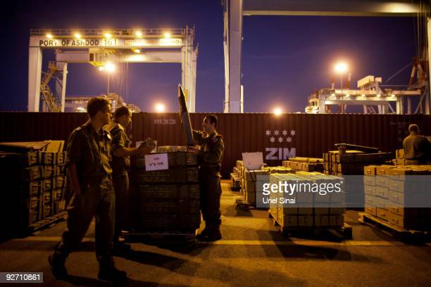 Israeli soldiers unload hundreds of tonnes of arms seized at dawn on a ship bound for Syria and the Hezbollah militia in Lebanon around 100 nautical...