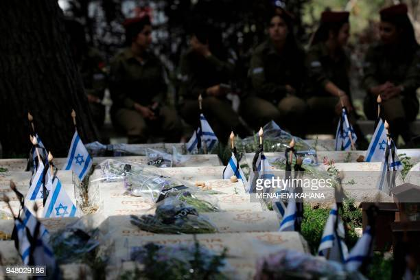 Israeli soldiers visit the graves of their fallen comrades during a Remembrance Day ceremony commemorating Israel's fallen soldiers at the Mount...