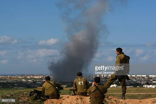 Israeli soldiers watch an Air Force bombing attack against the northern Gaza Strip town of Beit Hanoun January 9 2009 as seen from Israel's border...