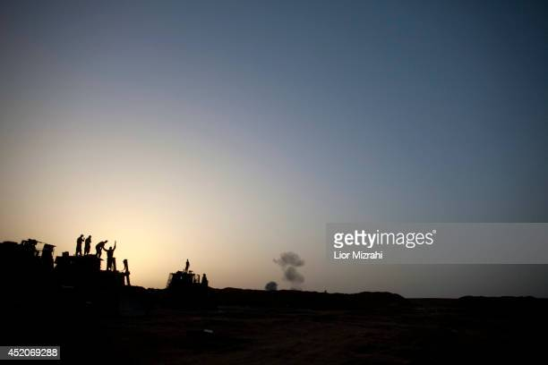Israeli soldiers watch smoke plumes rises from Gaza following an Israel Air Force bombing on July 12 2014 in Israel Gaza border Israel's operation...