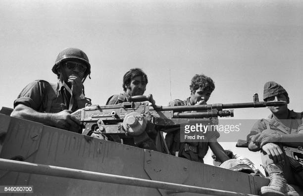 Israeli soldiers with a machine gun on top of their armored vehicle during the Yom Kippur war