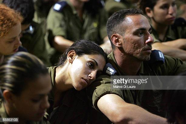 Israeli soldiers with the Blue Battalion attend the final speech from their commander, Col. Chaim Moria, before disengagement operations begin at...