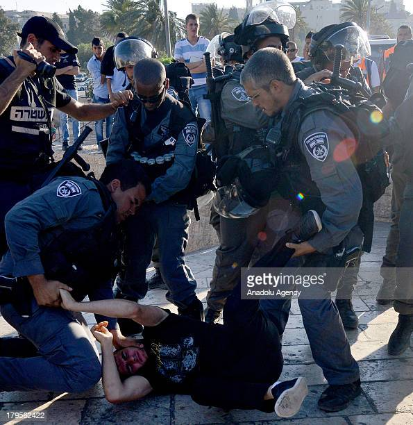 Israeli soliders detain a Palestinian young man on 26 August 2013 in Jerusalem The demonstrators are protesting after Israel security forces raided...
