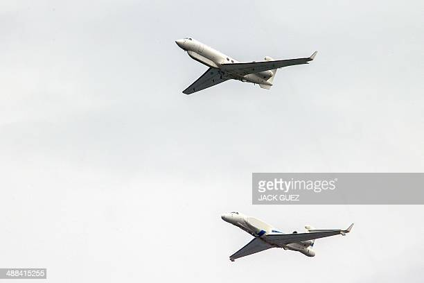 Israeli spy planes Eitam perform during an air show over the beach in the Mediterranean coastal city of Tel Aviv on May 6 2014 as Israel marks...