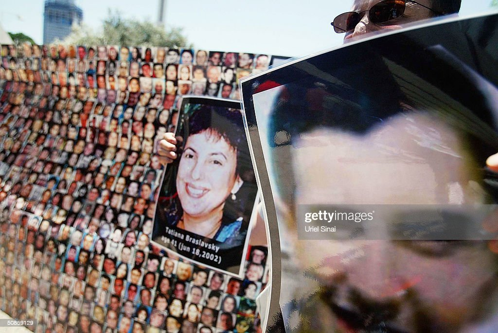 Israeli students hold up posters of Israelis killed in terror attacks during their demonstration outside the Tel Aviv District Court during the judgement hearing of Marwan Barghouti, on May 20, 2004 in Tel Aviv, Israel. Barghouti, head of the Palestinian Fatah Tanzim and al-Aksa Martyrs Brigades, was convicted of five counts of murder.
