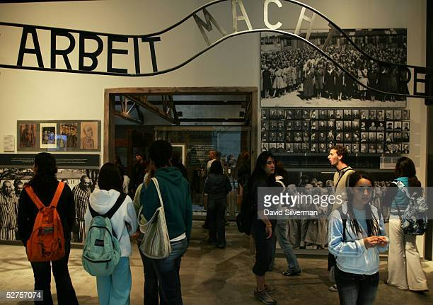 "Israeli students walk under a replica of the ""arbeit macht frei"" sign as they visit the Yad Vashem Holocaust Memorial museum May 4, 2005 in..."