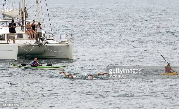 Israeli swimmers are welcomed at the Marina in the Israeli coastal city of Herzliya after swimming in turns 400 kms from the Mediterranean island of...