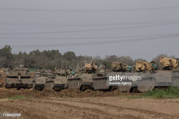 Israeli tanks and armoured vehicles are deployed at blockaded Gaza Strip border ahead of demonstrations of Palestinians for the 43rd anniversary of...