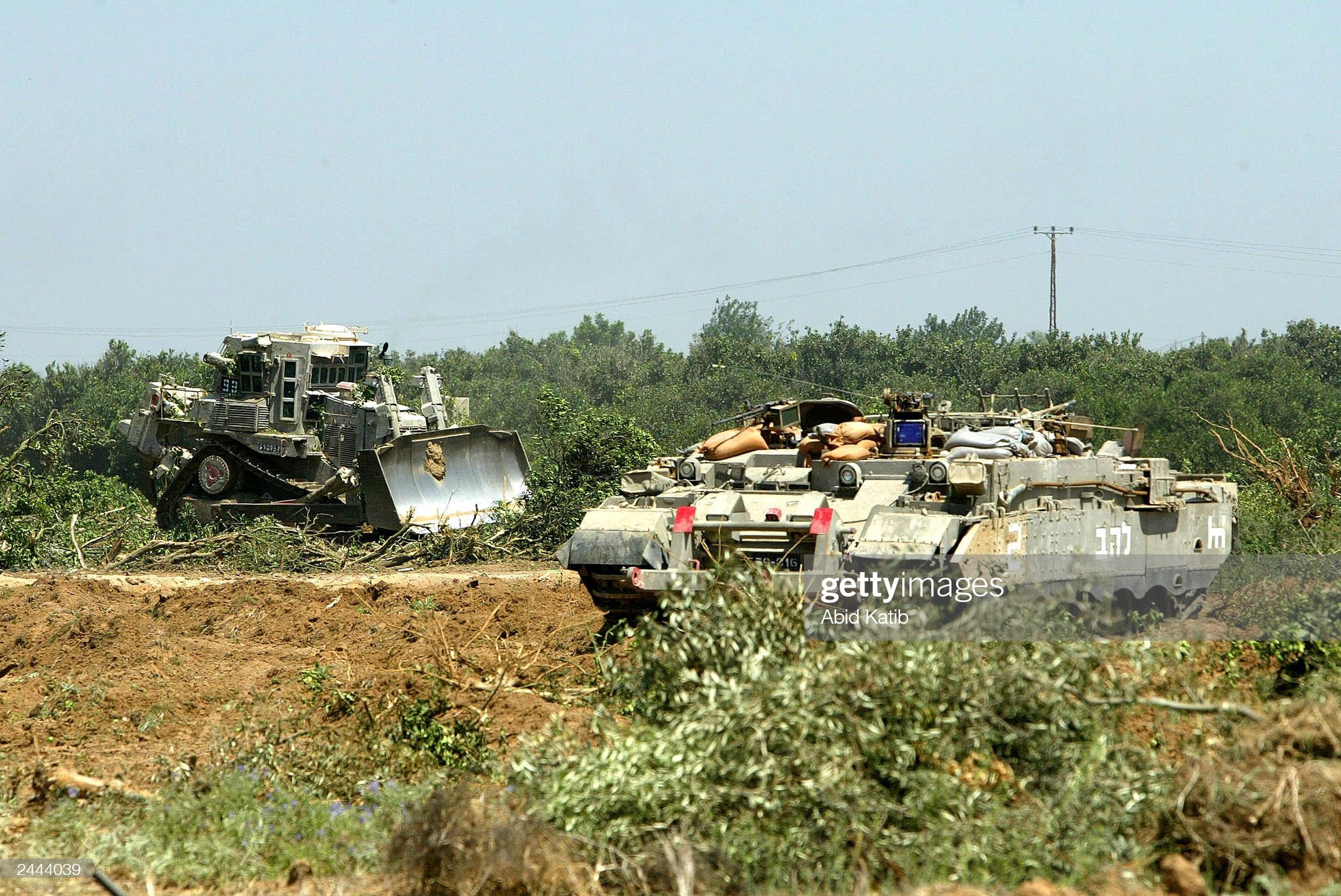 https://media.gettyimages.com/photos/israeli-tanks-and-bulldozers-destroy-orange-groves-august-29-2003-in-picture-id2444039?s=2048x2048