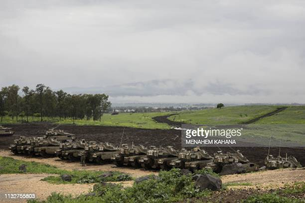 Israeli tanks are lined up in a training area near the settlement of Katzrin in the Israeliannexed Golan Heights on March 25 2019 US President Donald...