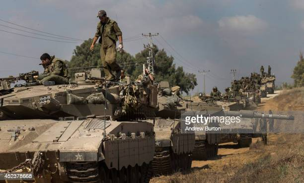 Israeli tanks are lined up near the IsraeliGaza border during an operation on July 19 2014 near Sderot Israel As operation 'Protective Edge' enters...