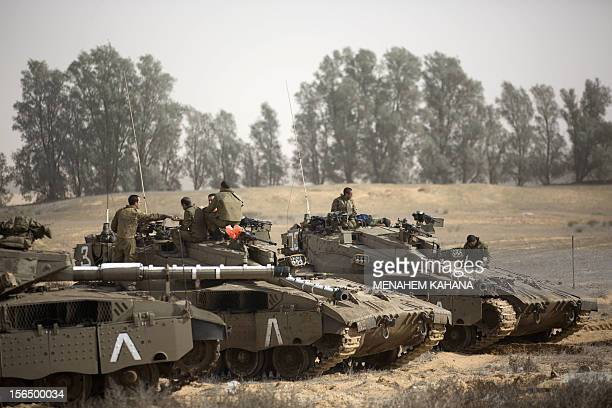 Israeli tanks are stationed at the IsraeliGaza Strip border on November 16 2012 Israeli officials said the Jewish state was preparing to launch its...