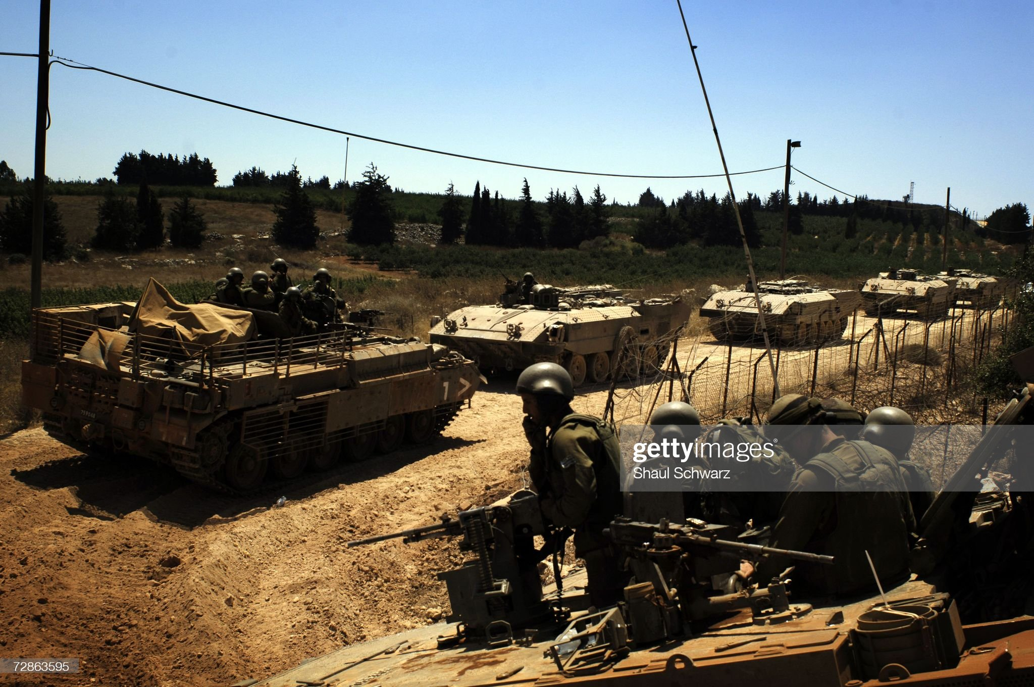 https://media.gettyimages.com/photos/israeli-tanks-drives-along-the-border-before-crossing-it-for-action-picture-id72863595?s=2048x2048