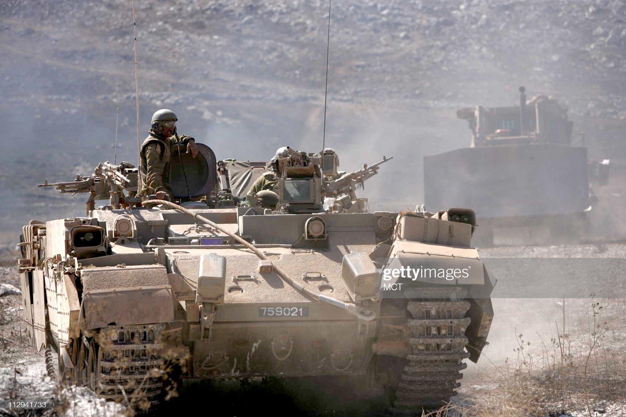 https://media.gettyimages.com/photos/israeli-tanks-in-bint-jbeil-move-towards-the-lebaneseisraeli-border-picture-id112941733?s=2048x2048