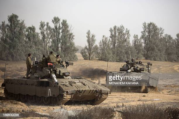 Israeli tanks maneuver at the IsraeliGaza Strip border on November 16 2012 Israeli officials said the Jewish state was preparing to launch its first...
