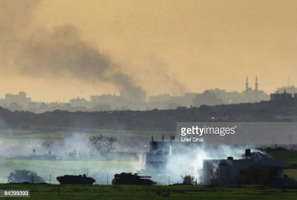 Israeli tanks operate inside Gaza on January 15 2009 seen from the Israeli side of the border with the Gaza Strip Israel has been condemed for using...