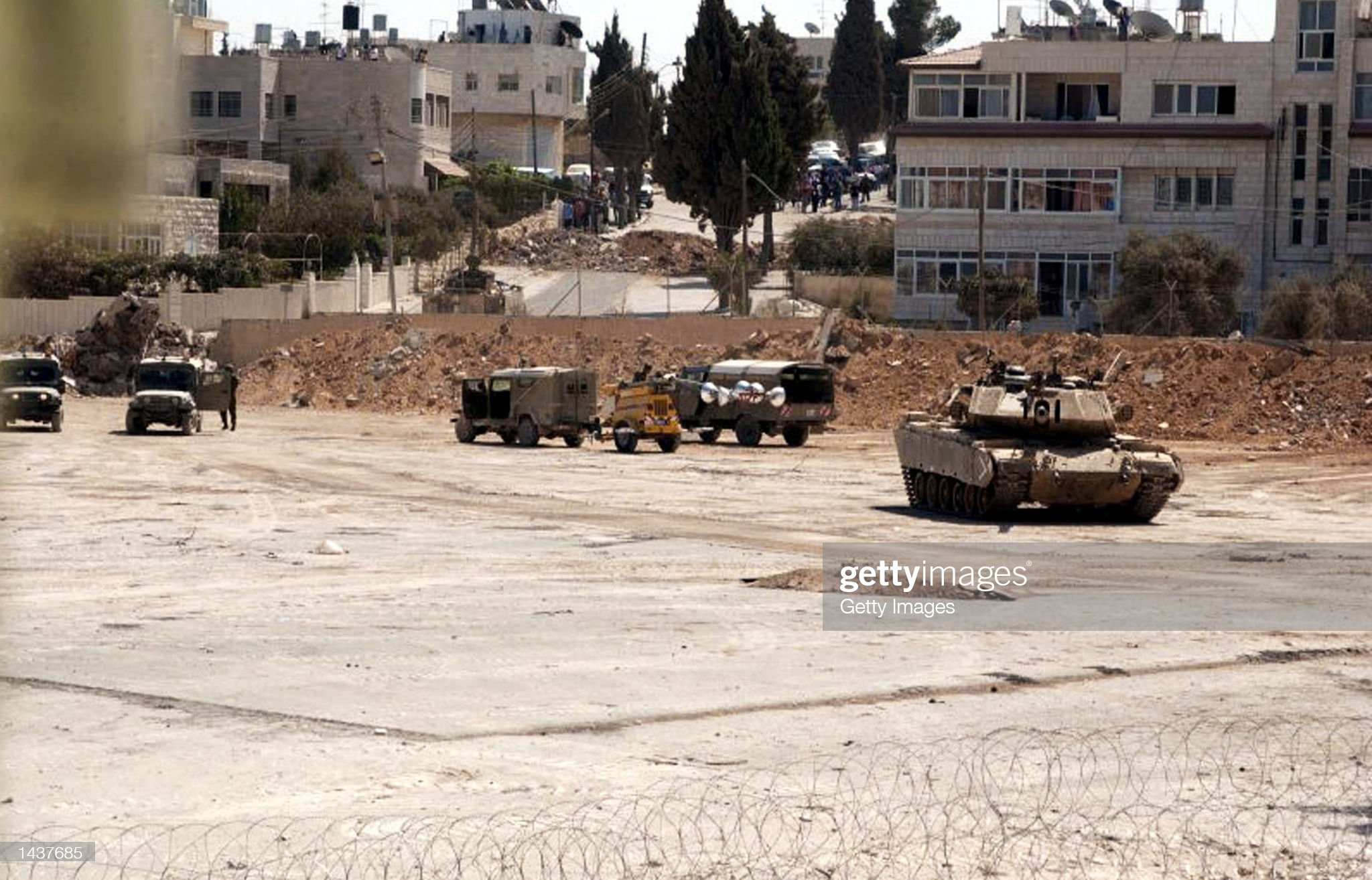 https://media.gettyimages.com/photos/israeli-tanks-pull-out-of-palestinian-leader-yasser-arafats-mukataa-picture-id1437685?s=2048x2048
