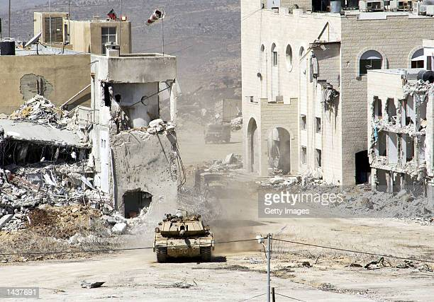 Israeli tanks pull out of Palestinian leader Yasser Arafat's Mukata'a compound September 29 2002 in Ramallah West Bank After a personal message from...