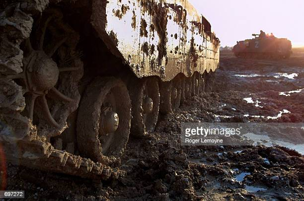 Israeli tanks return to the Erez crossing February 13 2002 after spending the day conducting operations in the Gaza Strip Israeli troops raided three...