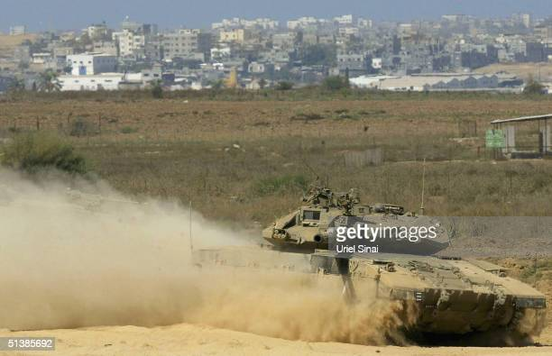 Israeli tanks roll at the border between Kibbutz Mefalsim and the Gaza Strip October 3 2004 in Gaza Strip Israeli Prime Minister Ariel Sharon vowed...