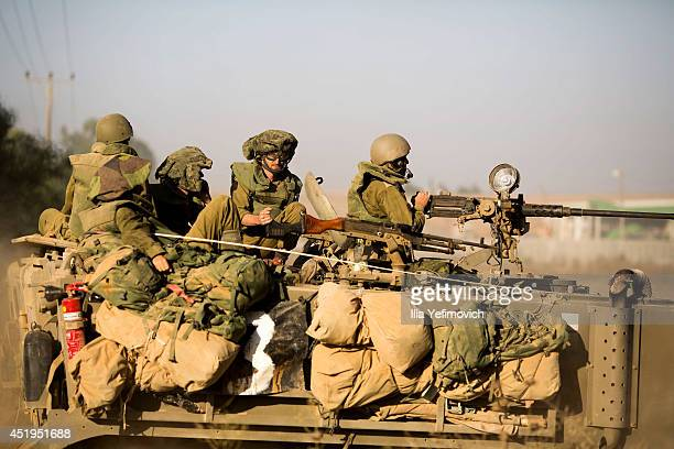 Israeli tanks seen moving along the border with Gaza on July 10 2014 on Israel's border with the Gaza Strip Due to recent escalation in the region...