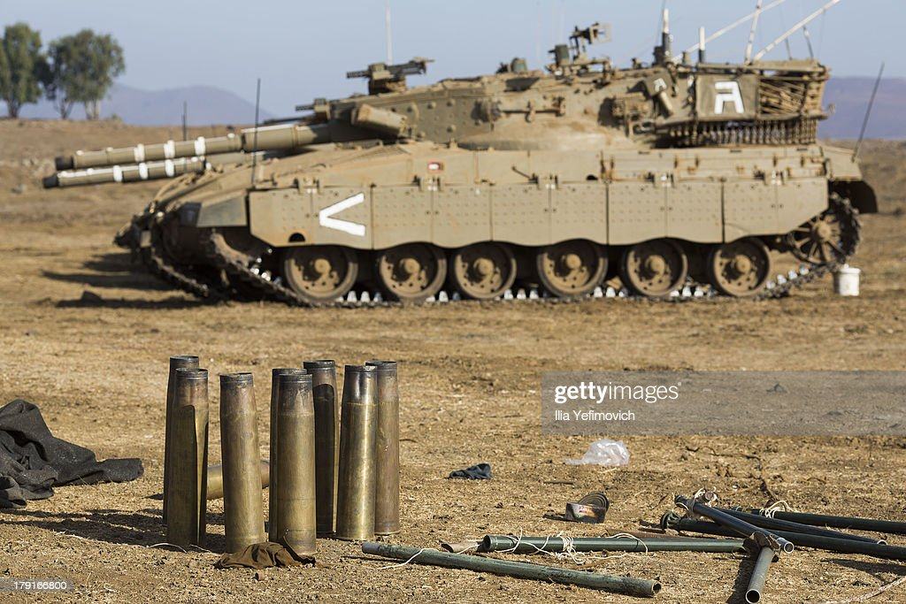 Israeli tanks seen on September 1, 2013 near the border with Syria, in the Israeli-annexed Golan Heights. Tension's are rising in Israel amid international talks of a military intervention In Syria.