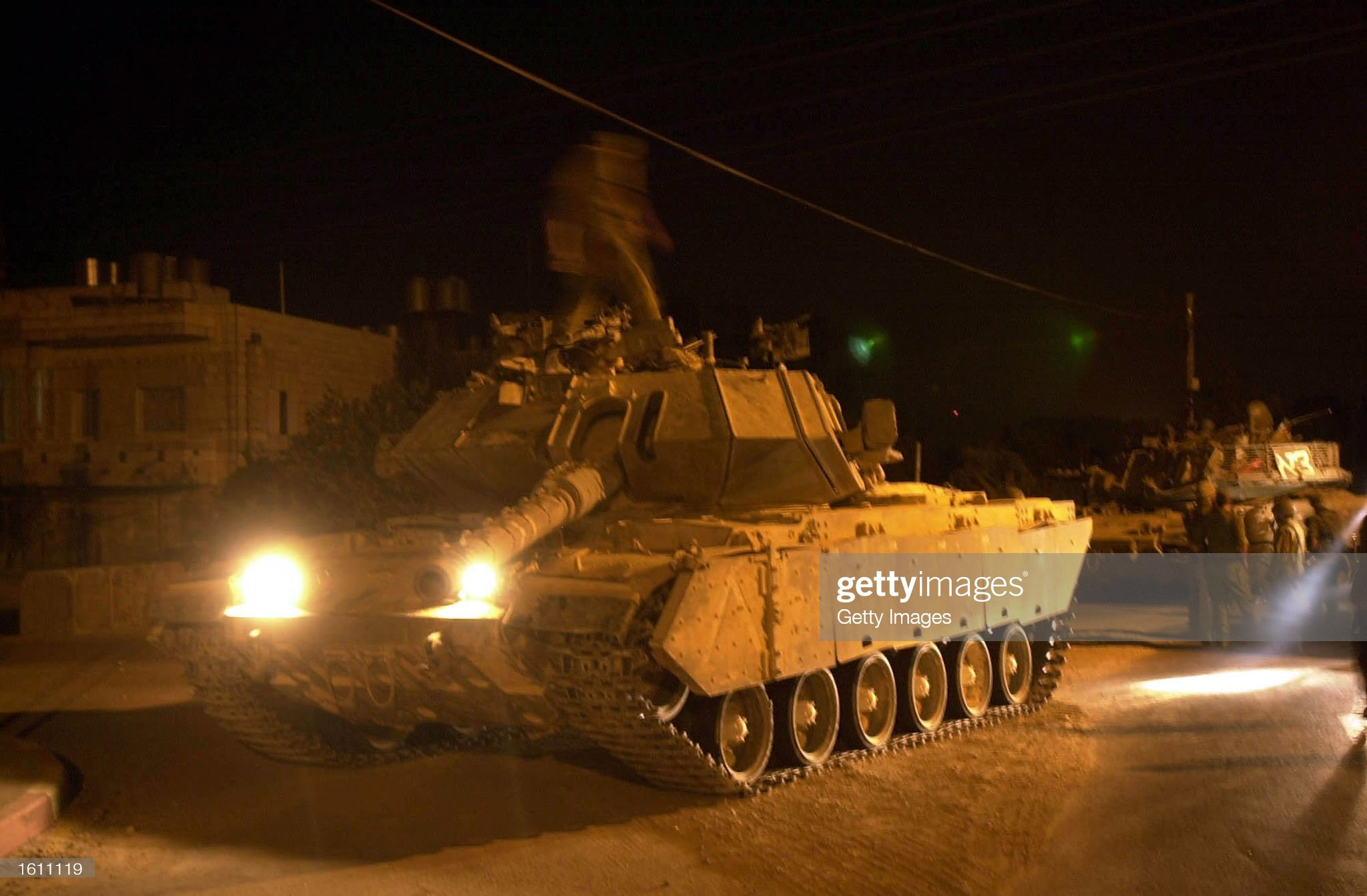 https://media.gettyimages.com/photos/israeli-tanks-stand-at-the-entrance-of-the-palestinian-town-of-beit-picture-id1611119?s=2048x2048