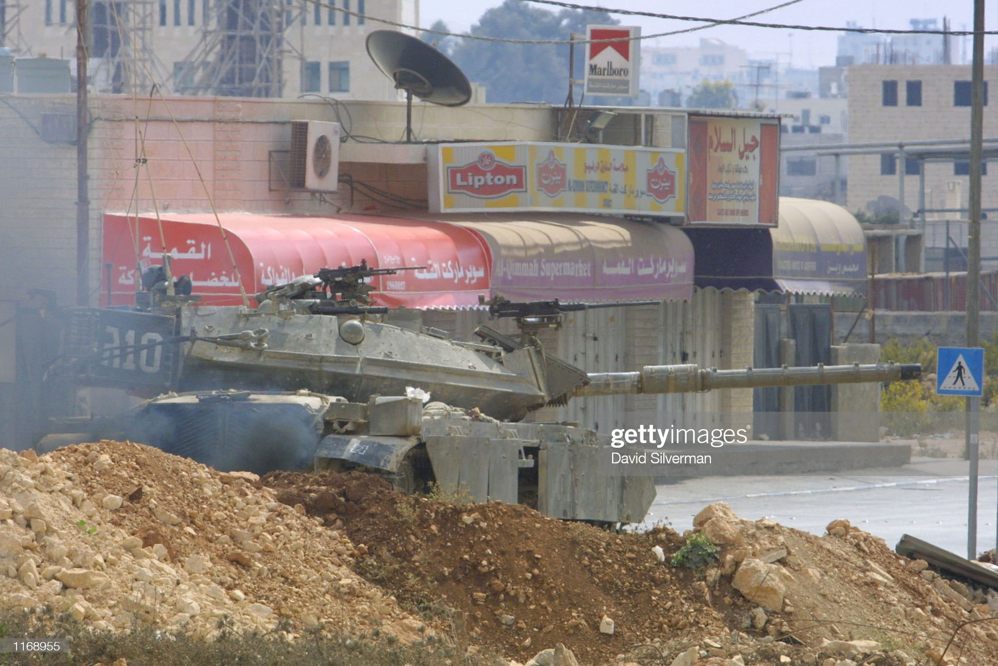 https://media.gettyimages.com/photos/israeli-tanks-take-position-october-18-2001-in-the-west-bank-town-of-picture-id1168955?s=2048x2048