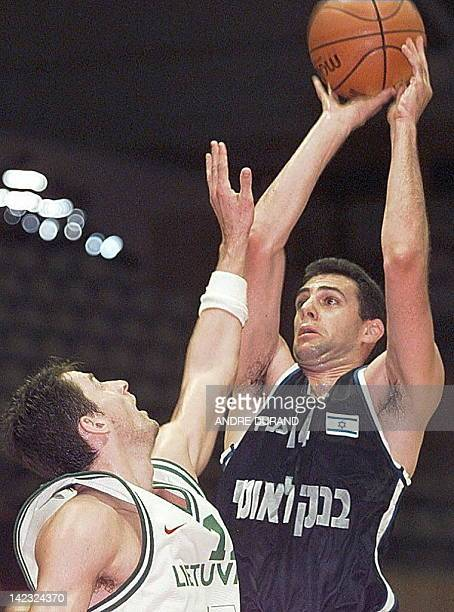 Israeli Tomer Steinhauer is challenged by Lithuania's Arturas Karnisovas during their European Championship match in Gerona 25 June