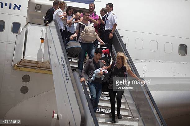 Israeli travelers with their new born babies from surrogate mothers in Nepal disembark from an Israeli rescue plane after it landed at Ben Gurion...