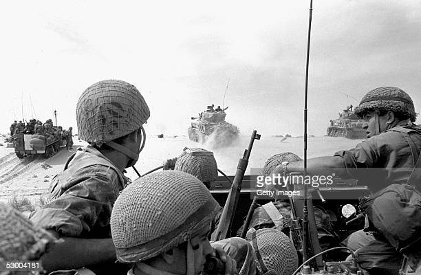 Israeli troops and armor advance against Egyptian troops at the start of the SixDay War June 5 1967 near Rafah Gaza Strip Thirtyeight years after...
