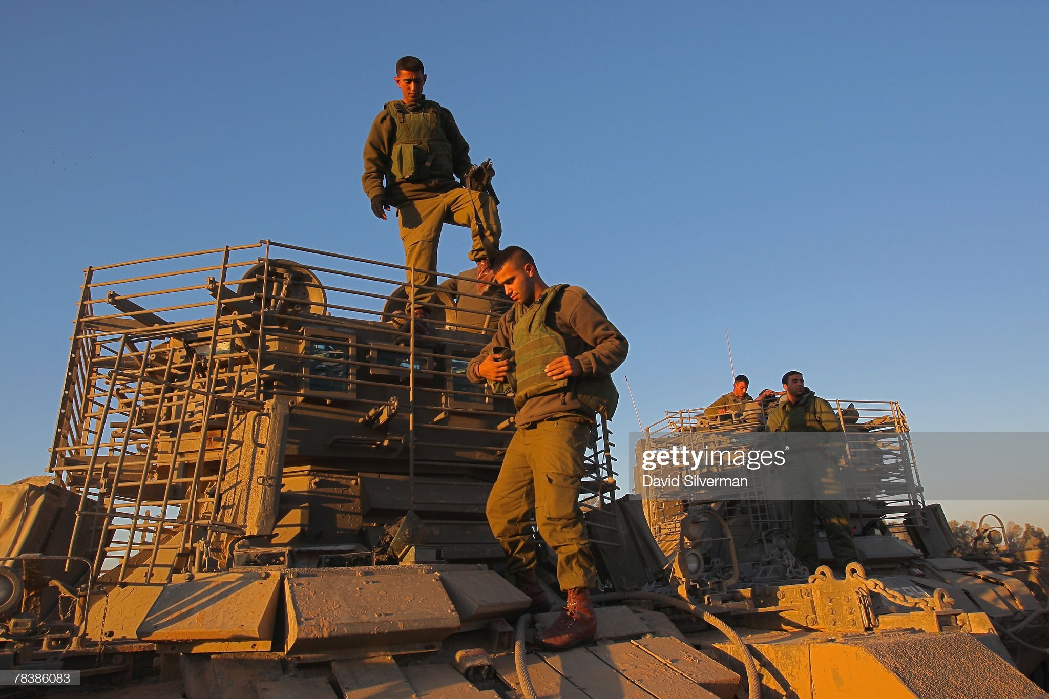 https://media.gettyimages.com/photos/israeli-troops-dismount-their-armoured-fighting-vehicles-on-returning-picture-id78386083?s=2048x2048