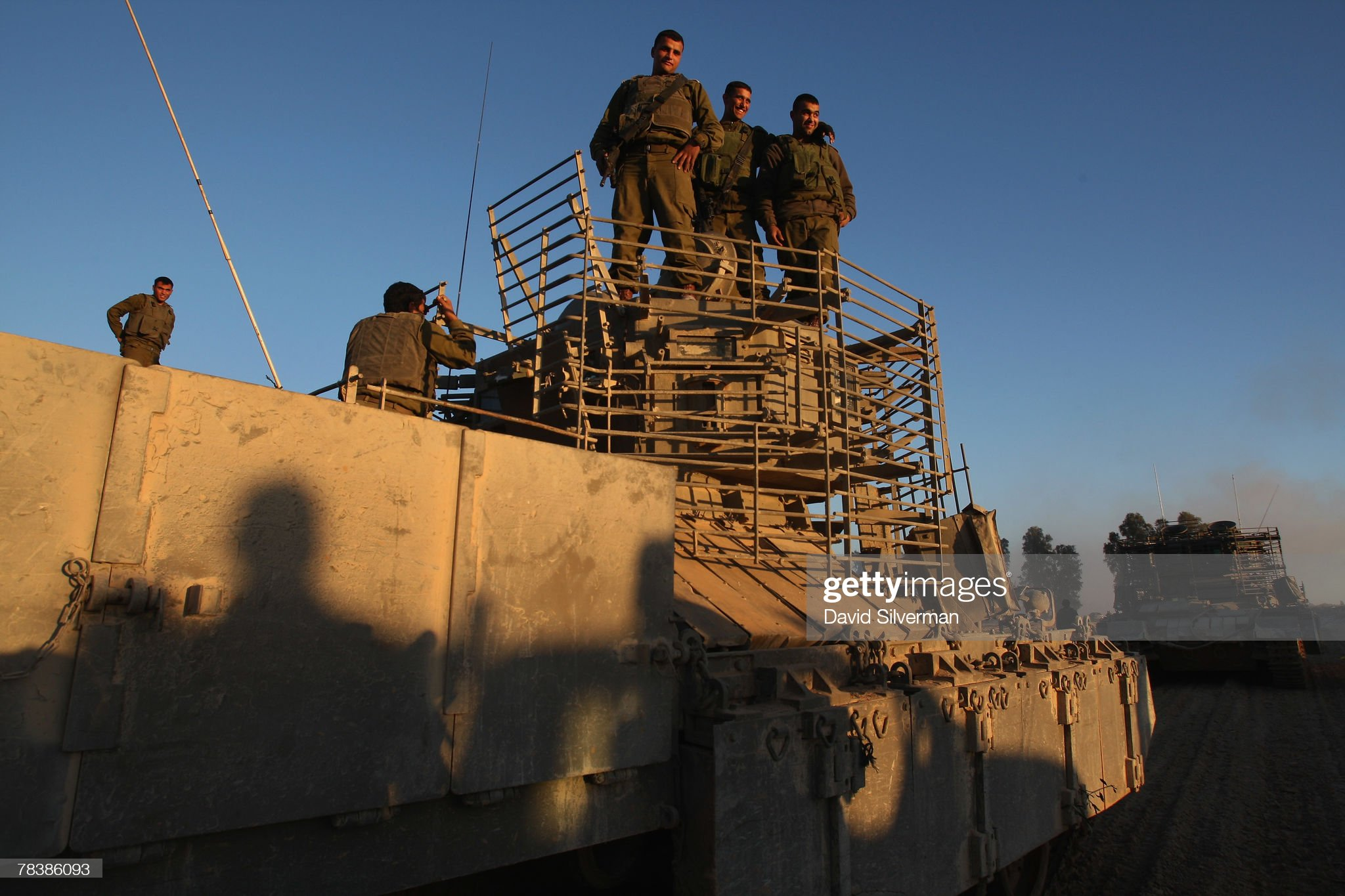https://media.gettyimages.com/photos/israeli-troops-dismount-their-armoured-fighting-vehicles-on-returning-picture-id78386093?s=2048x2048