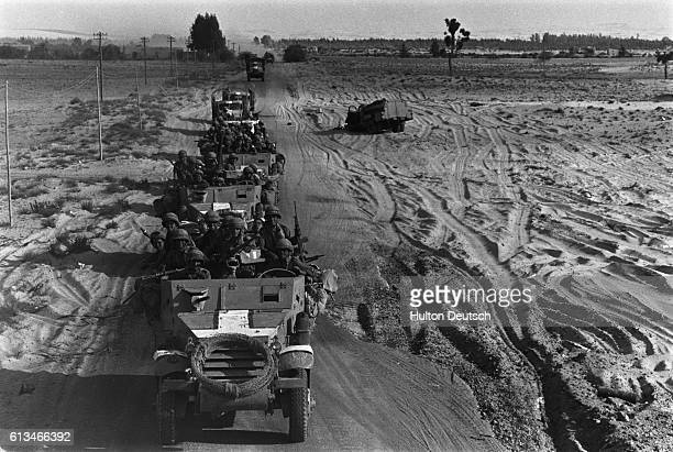 Israeli troops drive their vehicles in a convoy through the desert during the SixDay War