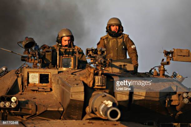 Israeli troops ride a tank towards the Gaza Strip on January 5 2009 near Israel's border with the Palestinian territory Israel is intensifying its...