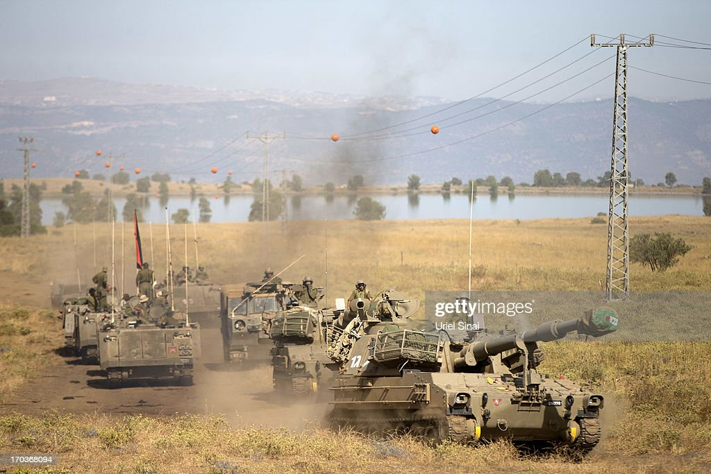 Israeli Troops Train At The Golan Heights : News Photo