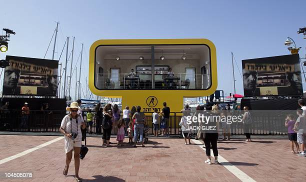 Israeli TV personalities Eliraz Sade and Nathan Bashevkin take part in the �Live billboard' event at the marina in Herzliya north of Tel Aviv on...