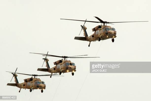 Israeli UH60 Black Hawk helicopters perform during an air show at the graduation ceremony of Israeli air force pilots at the Hatzerim Israeli Air...