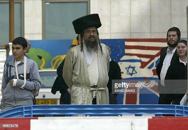 Israeli ultra orthodox Jews wait outside the entrance of the emergency ward at the Hadassah hospital on the outskirts of Jerusalem 11 February 2006...