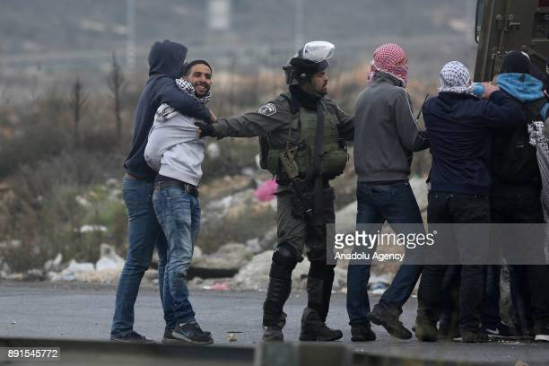Israeli undercover police officers detain Palestinian protester as they intervene in a demonstration against US President Donald Trump's recognition...