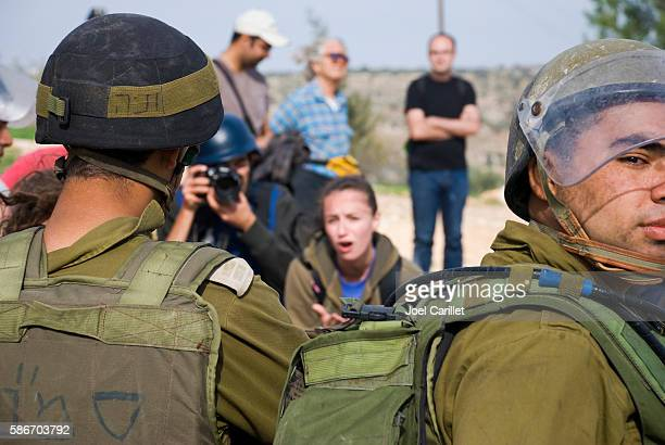 Israeli university student pleading with soldiers in Bil'in, West Bank