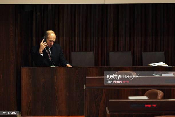 Israeli Vice Premier Ehud Olmert speaks at the phone in the Knesset, Israeli Parliament, on November 11, 2005 in Jerusalem, Israel.