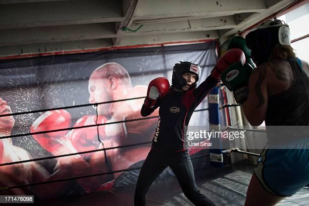 Israeli WIFB Bantamweight Boxing world champion Hagar Finer fights her training partner during a training session on June 25 2013 in Tel Aviv Israel...