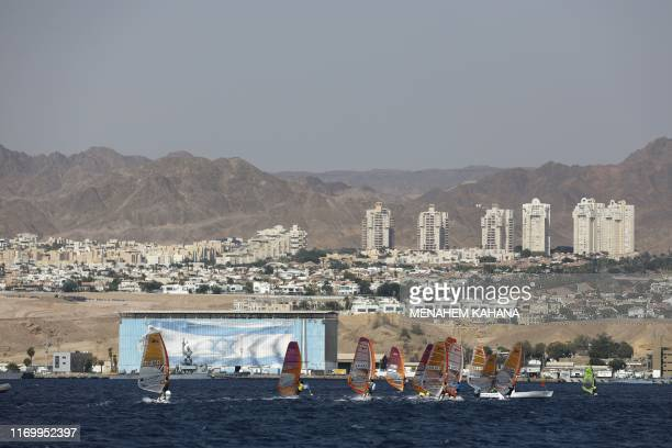 Israeli wind surfers take part in the Red Sea Eco Festival off the southern Israeli resort city of Eilat on September 21 to honour the International...