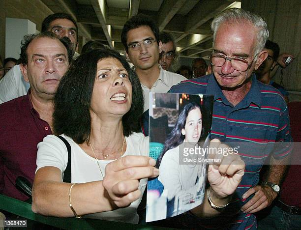 Israeli woman Brigitte Kessler holds a photograph of her daughter Gila as she calls for the death penalty for Palestinian leader and West Bank chief...
