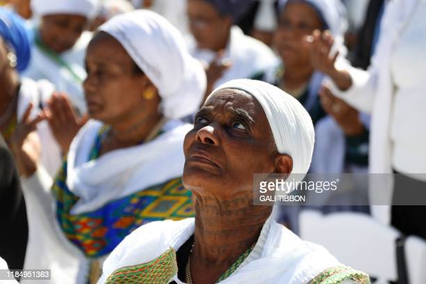 Israeli women from the Ethiopian Jewish community pray during the Sigd holiday marking the desire to 'return to Jerusalem' as they celebrate from a...