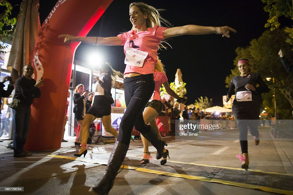 Israeli women race in high heels in support of breast cancer    News
