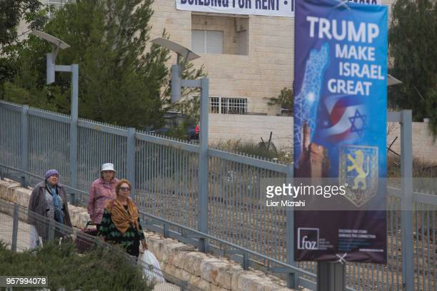 Israeli women walk next to a sign outside the US consulate that will act as the new US embassy in May 13 2018 in Jerusalem Israel Trump's...